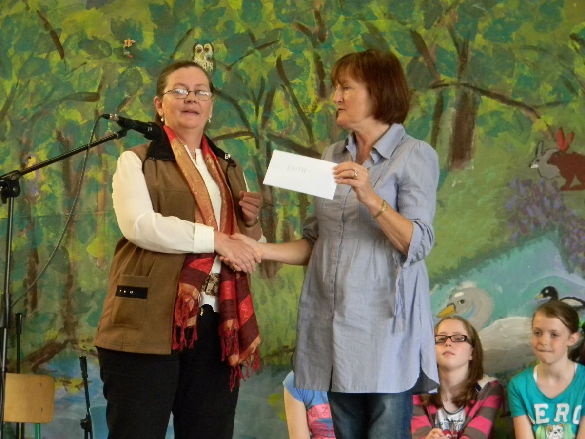 Mrs. Ryan presents cheque to Edith Wilkins